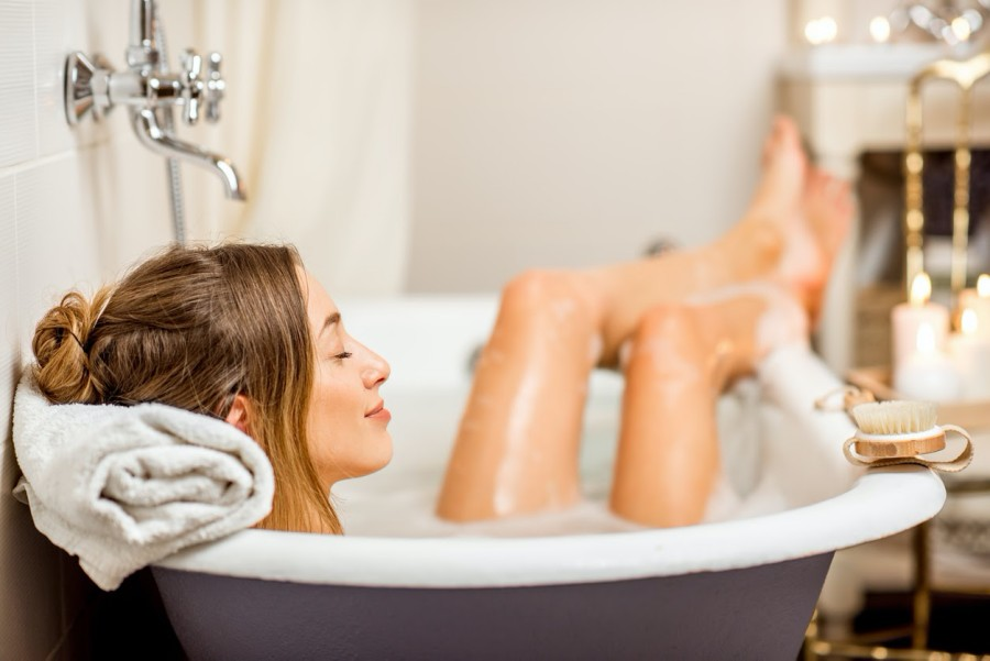 Young woman relaxing in the bathtub